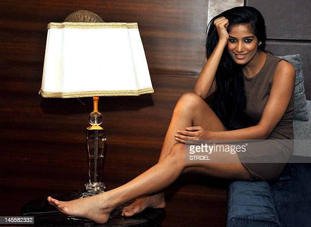 Indian model Poonam Pandey poses for a candid photo shoot in Mumbai on June 1 2012 AFP PHOTO/ STR