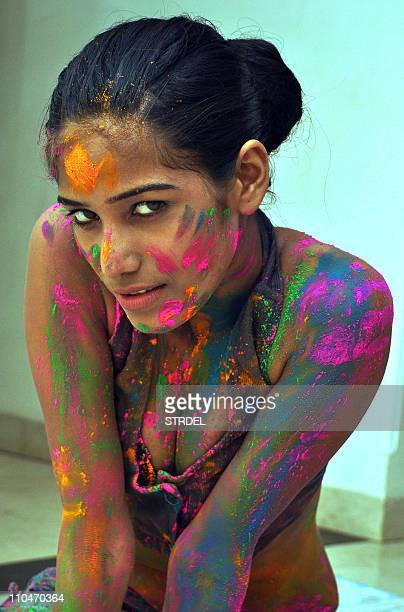 Indian model Poonam Pandey prepares to celebrate the Indian Hindu Festival of 'Holi' in Mumbai late March 18 2011AFP PHOTO/STR