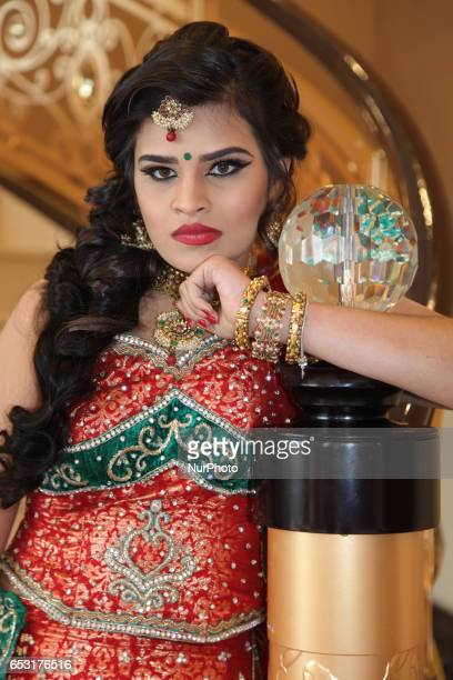 Indian model wearing an elegant and ornate bridal outfit during a South Asian bridal show held in Scarborough Ontario Canada