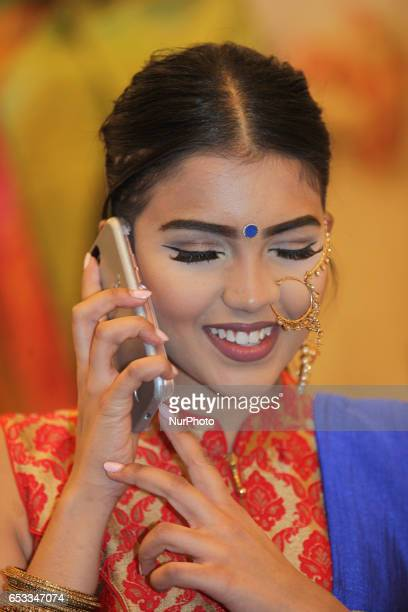 Indian model wearing elegant bridal jewellery talking on a mobile phone during a South Asian bridal show held on 14 March 2017 in Scarborough Ontario...
