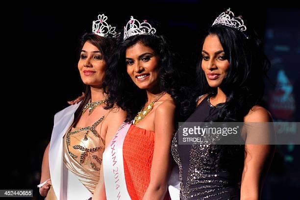 Indian models and competition runnersup Chandrika Ravi and Kangna Sharma and winner Swapnila Gupta are photographed at the KamaSutra Miss Maxim 2014...
