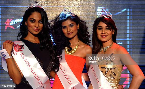 Indian models and competition runnersup Kangna Sharma and Chandrika Ravi and winner Swapnila Gupta are photographed at the KamaSutra Miss Maxim 2014...