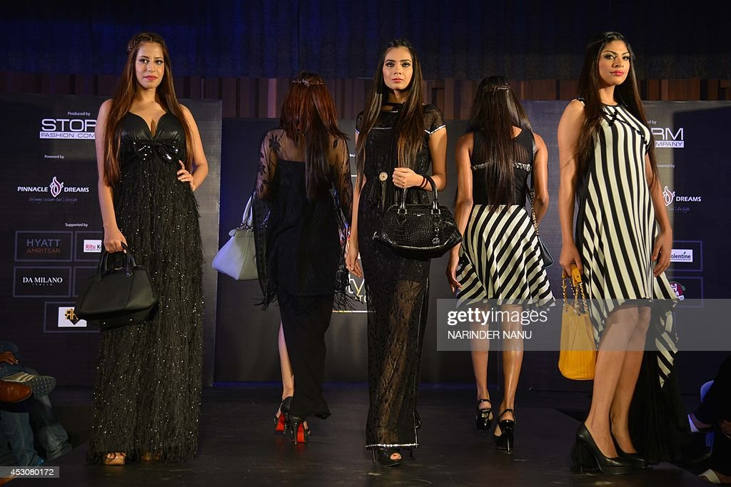 Indian models display creations by Indian designer Jattinn Kochhar and Sheetal Lyall during a fashion show Kingfisher Ultra Punjab Style Tour in Amritsar on August 2, 2014 .