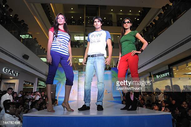 Indian models display the Monte Carlo Spring Summer Collection 2012 at the Alphaone Mall in Ahmedabad on May 19 2012 AFP PHOTO / Sam PANTHAKY