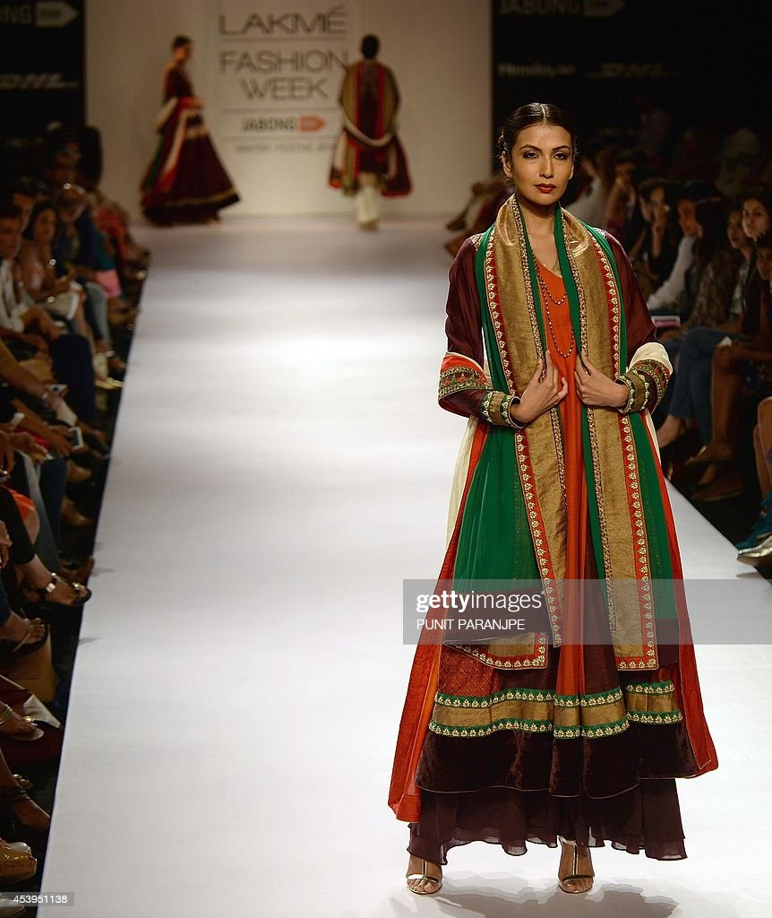Indian models showcase creations by designer Ekru on the third day of the Lakme Fashion Week (LFW) Winter/Festival 2014 in Mumbai on August 22, 2014. The LFW, held twice annually, features creations by over 86 designers and will culminate on August 24.