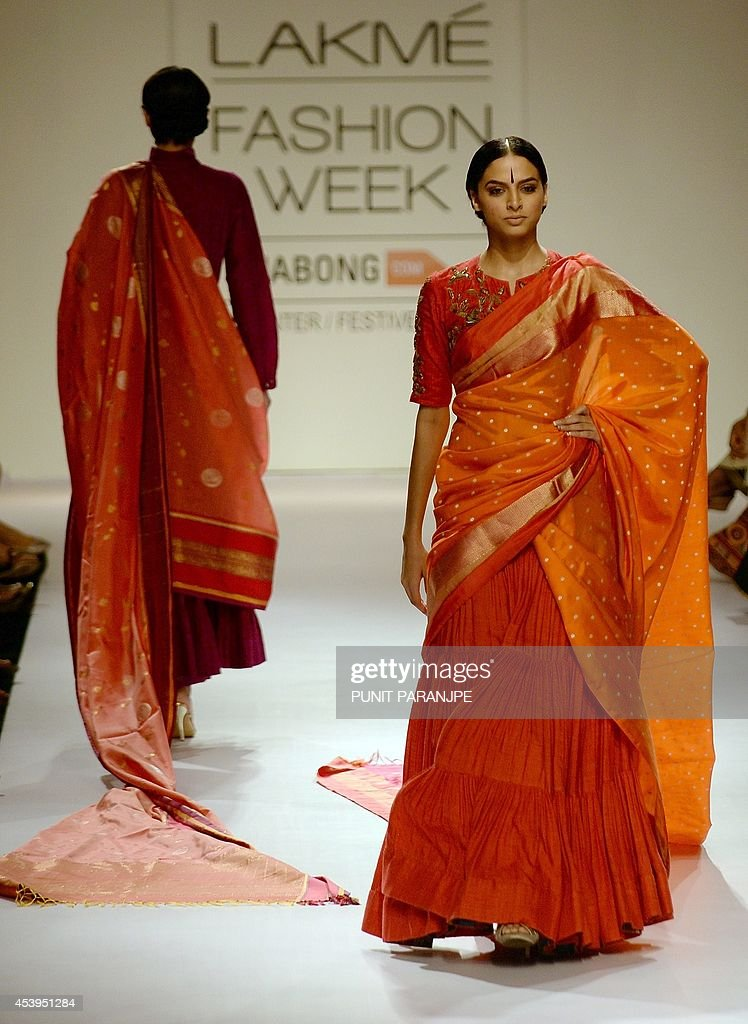 Indian models showcase creations by designer Gaurang on the third day of the Lakme Fashion Week (LFW) Winter/Festival 2014 in Mumbai on August 22, 2014. The LFW, held twice annually, features creations by over 86 designers and will culminate on August 24.