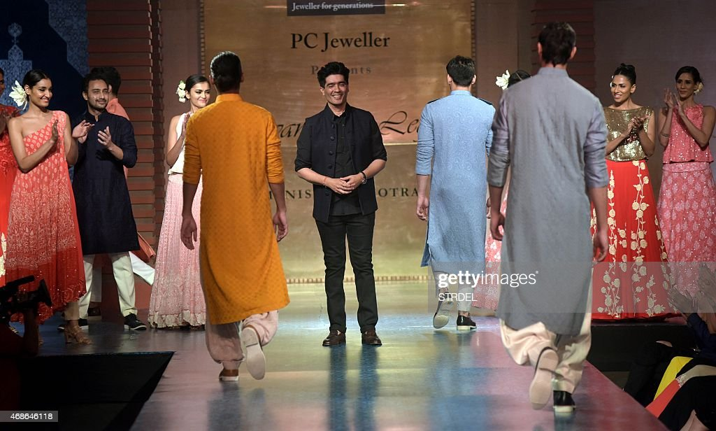 Indian models showcase creations by designer <a gi-track='captionPersonalityLinkClicked' href=/galleries/search?phrase=Manish+Malhotra+-+Fashion+Designer&family=editorial&specificpeople=4458343 ng-click='$event.stopPropagation()'>Manish Malhotra</a> (C) during a charity fashion show in Mumbai on late April 4, 2015. AFP PHOTO / STR