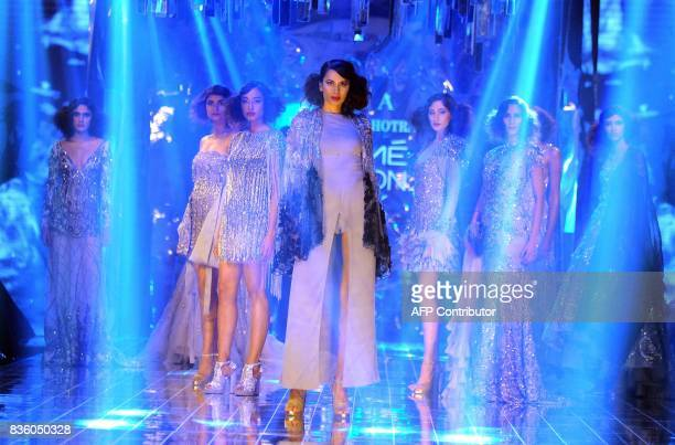 Indian models showcases creations by designer Manish Malhotra during the grand finale of Lakme Fashion Week Winter/Festive 2017 in Mumbai on August...