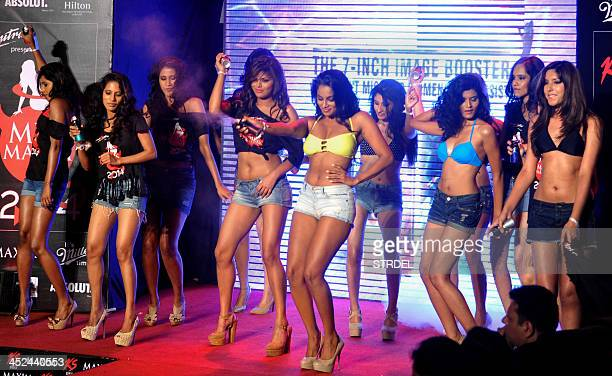 Indian models walk the ramp as they take part in the KamaSutra Miss Maxim 2014 competition final in Mumbai on November 282013 AFP PHOTO/STR