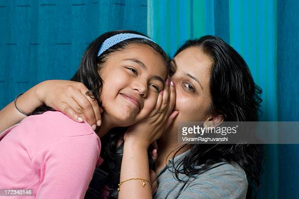 Indian Mother sharing a secret with her daughter People Horizontal