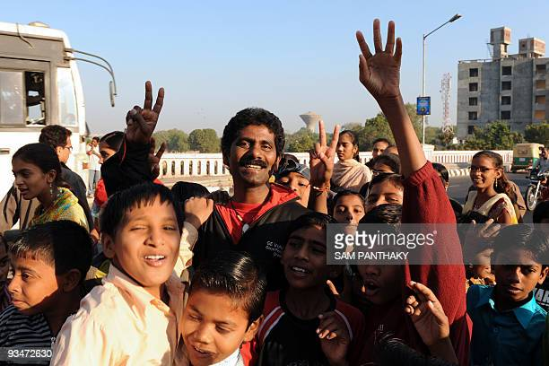 Indian mountaineer Malli Mastan Babu poses with children in Ahmedabad on November 29 following a morale run with some 125 underpriviledged children...