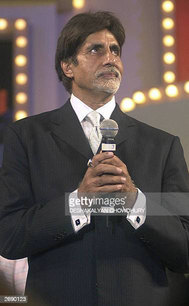 Indian movie star Amitabh Bachchan attends the 66th Bengal Film Journalists' Association award ceremony in Calcutta 01 November 2003 during which he...