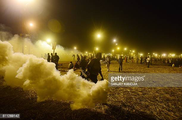 TOPSHOT Indian municipal employees fumigate to deter mosquitoes during the annual Magh Mela festival at Sangam in Allahabad on February 19 2016 AFP...