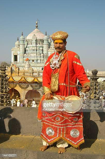 Indian Musical Instrument Player Sambal With Background Of Khandoba At Jejuri Pune Maharashtra India