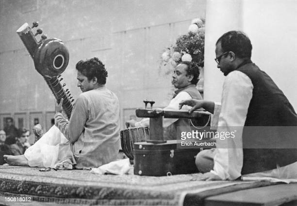 Indian musician and composer Ravi Shankar playing a sitar in a concert with tabla player Alla Rakha and tanpura player Prodyot Sen 15th October 1958