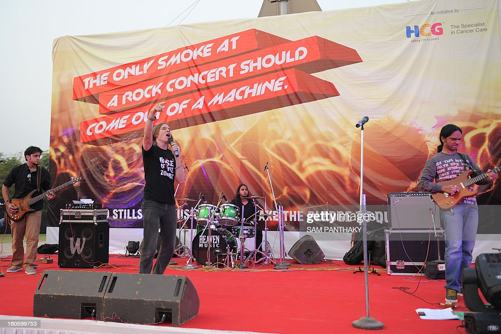 Indian musician and entertainer Luke Kenny performs during an anti-tobacco rock concert on the outskirts of Ahmedabad on the eve of World Cancer Day, February 3, 2013. Live performances were performed by Luke Kenny, Caralisa Monteiro and other co-stars of 'Rise Of The Zombie Night'. AFP PHOTO / Sam PANTHAKY