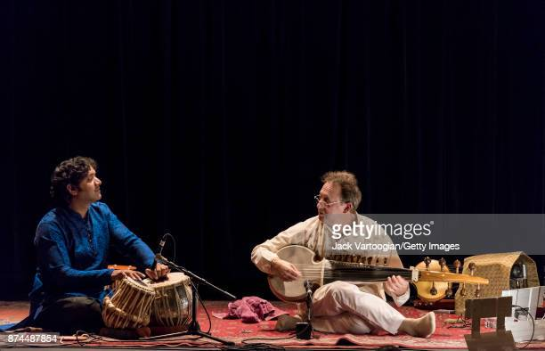 Indian musician Nitin Mitta on tabla and American musician Ken Zuckerman on sarod perform during a Robert Browning Associates 'Music of North India'...