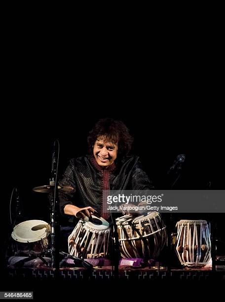Indian musician Zakir Hussain plays tabla as he leads his Pulse of the World Ensemble during a performance at Carnegie Hall New York New York March...