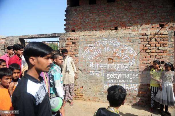 Indian Muslim butchers traders and their family members gather outside a shuttered illegal slaughterhouse in the Naini neighborhood of Allahabad on...