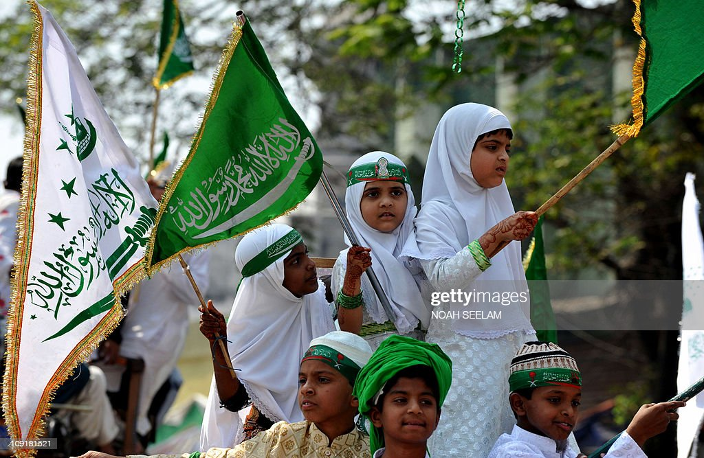 Indian Muslim children participate in an Eid Milad-un-Nabi festival procession in Hyderabad on February 16, 2011.Thousands of Muslims staged rallies across the country to celebrate Eid Milad-un-Nabi, which marks the birth anniversary of Prophet Mohammed,who was,who was born in the Saudi Arabian city of Mecca on the 12 th day of Rabi-Ul-Awwal 571 A.D .AFP PHOTO / Noah SEELAM