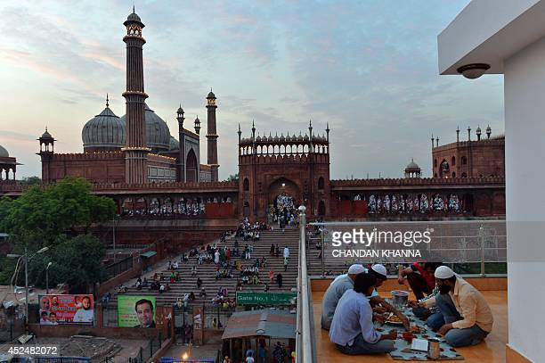 Indian Muslim devotees break their fast during the Islamic holy month of Ramadan at a mosque in New Delhi on July 21 2014 During the holy month of...