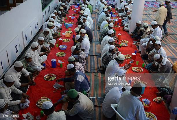 Indian Muslim devotees break their Ramadan fast with Iftar at the MasjidESyednaOmar Farooq in Hyderabad on July 1 2015 Muslims globally mark the...