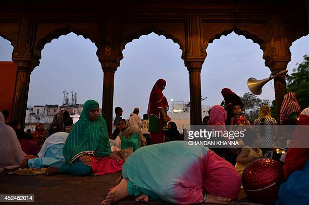 Indian Muslim devotees offer prayers during the Islamic holy month of Ramadan at a mosque in New Delhi on July 21 2014 During the holy month of...