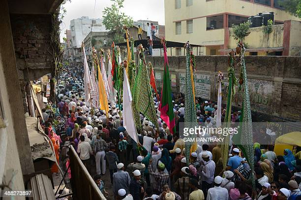 Indian Muslim devotees participate in a procession in memory of Sufi saint Hazrat Pir Mehmood Shah Bukhari in Ahmedabad on May 5 2014 The procession...
