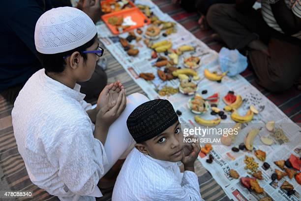 Indian Muslim devotees pray prior to breaking their fast on the Islamic holy month of Ramadan at the JamaeMasjid Aiwan in Hyderabad on June 22 2015...