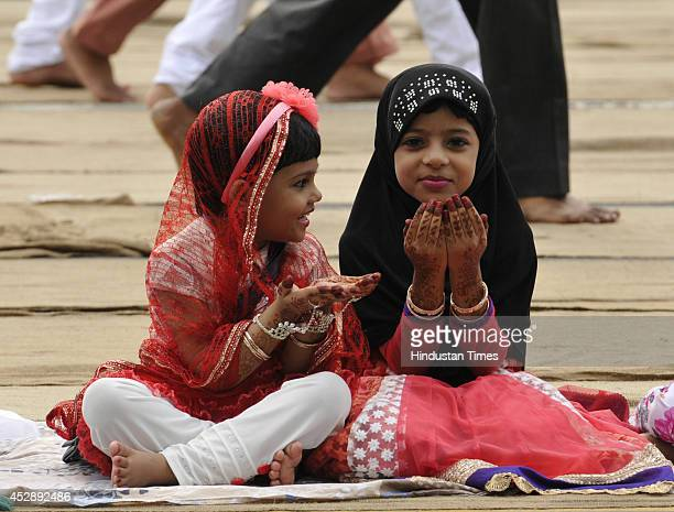 Indian Muslim girls offering prayer on the occasion of Eidulfitr at Red Road on July 29 2014 in Kolkata India The festival of Eid was celebrated with...