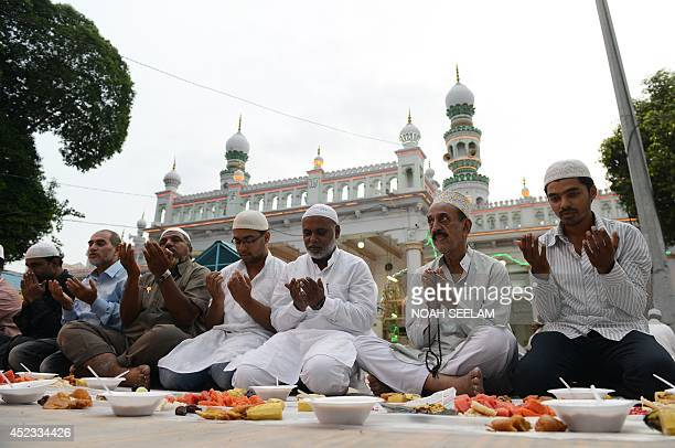 Indian Muslim offer prayers prior to breaking their fast during the holy month of Ramadan at Jama Masjid Mahaboob Chowk in Hyderabad on July 18 2014...