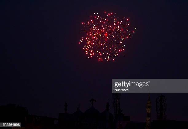 Indian muslim people celebrate as they fire crackers after rising of moonahead of Holy fasting month of Ramadanin Allahabad on June 182015More than...