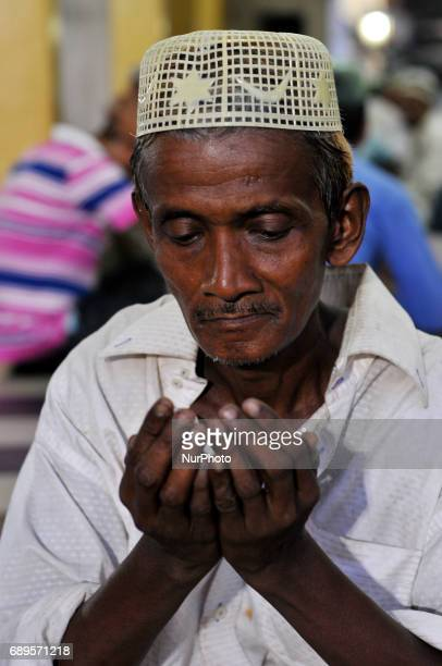 Indian Muslim pray at the historical Tipu Sultan Masque to break their first Roza as the holy month of Ramadan begins on May 28 2017 in Kolkata India...