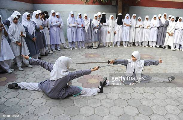 Indian Muslim schoolgirls perform 'Vovinam' the Vietnamese martial art at Saint Maaz High School in Hyderabad on January 24 to mark National Girl...