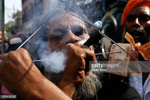 Indian Muslim Sufi holy men perform acts of self torture at a procession during the Urs festival at the shrine of Sufi saint Khwaja Moinuddin Chishti...