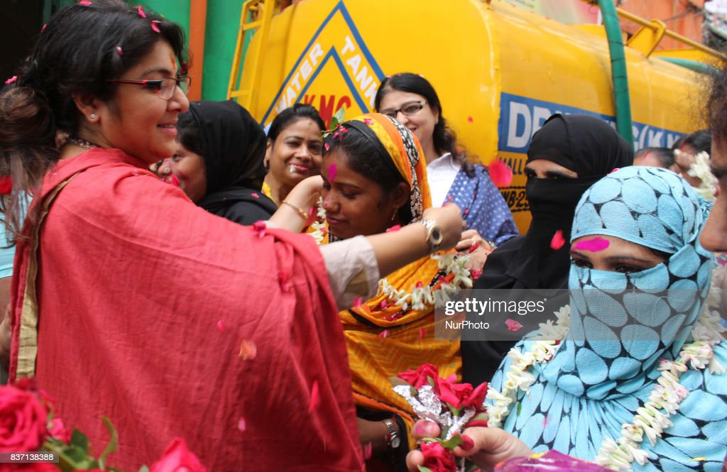 Indian Muslim Women celebrates with BJP political party State Women cell president Actress Loket Chatterjee after Triple Talaq issue Supreme Court Oder at on August 22,2017 in Kolkata, India.
