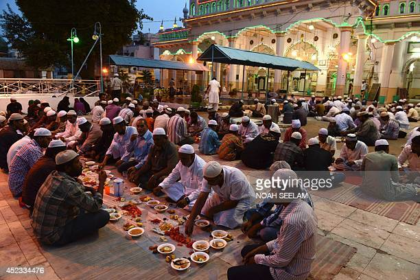 Indian Muslims break their fast during the holy month of Ramadan at Jama Masjid Mahaboob Chowk in Hyderabad on July 18 2014 Like millions of Muslim...