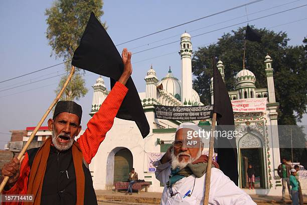 Indian Muslims chant slogans near a mosque to condemn the 20th anniversary of the Babri Masjid demolition in Ayodhya on December 6 2012 India risked...