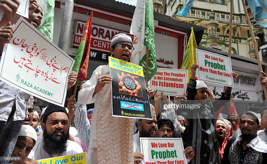 Indian Muslims hold placards and shout slogans during a protest in Mumbai on May 21, 2010. Hundreds of Muslims took part in a protest against the published caricatures of Prophet Mohammed on Facebook, the social networking site and demanded an immediate banning of Facebook. The caricatures appeared on Facebook after a private user asked people to submit drawings of the Prophet Mohammed in an online competition. AFP PHOTO/ Punit PARANJPE