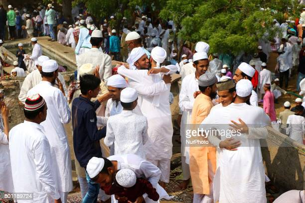 Indian Muslims hug each others after offering Eid alFitr prayers at the Idgah Mosque in DelhJaipur HighwayRajasthan India Monday June 26 2017 Eid...
