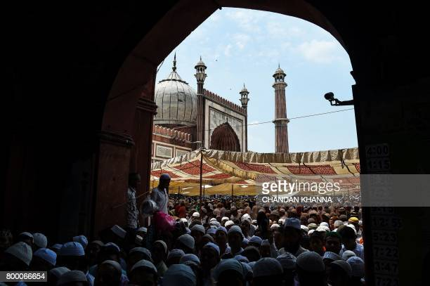 TOPSHOT Indian Muslims leaves the mosque on the last Friday of the holy month of Ramadan at the Jama Masjid mosque ahead of the Muslim festival of...
