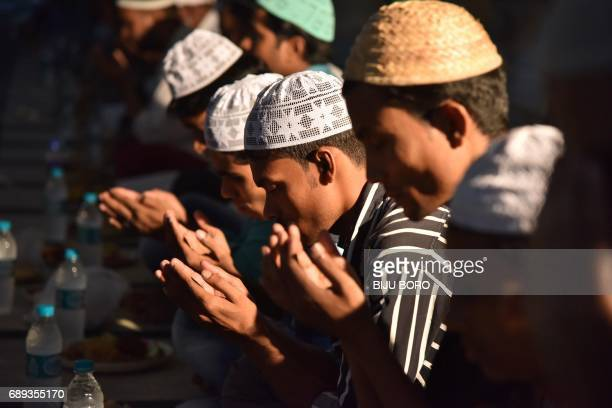 Indian Muslims men offer prayers before they break their fast on the first day of the month of Ramadan in Guwahati on May 28 2017 Like millions of...