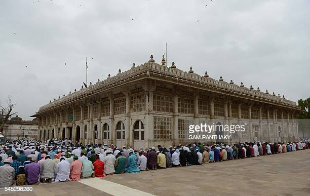 TOPSHOT Indian Muslims offer Eid alFitr prayers at the ancient Sarkhej Roza and Masjid in Ahmedabad on July 7 as they mark the end of the Islamic...