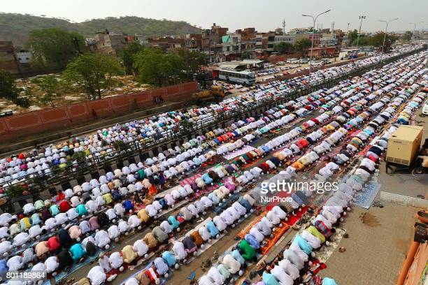 Indian Muslims offer Eid alFitr prayers at the Idgah Mosque in DelhJaipur HighwayRajasthan India Monday June 26 2017 Eid alFitr marks the end of the...
