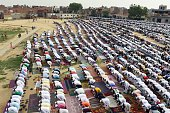 Indian muslims offer Eid prayers at Eid Gah Ground in Pasonda Ghaziabad some 30 kms east of New Delhi on July 7 2016 The threeday festival which...