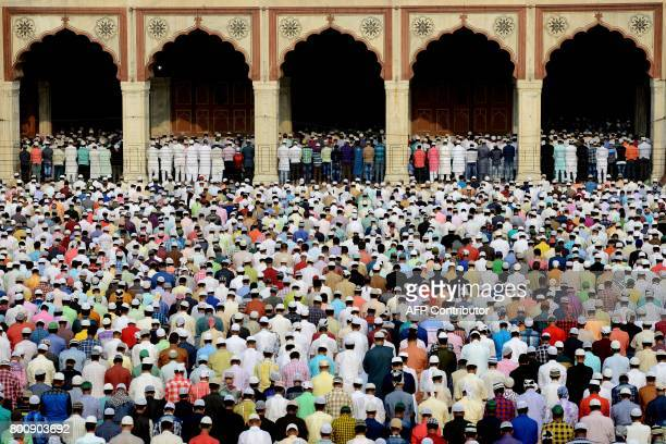 Indian Muslims offer prayers during Eid alFitr at Jama Masjid mosque in New Delhi on June 26 2017 Muslims around the world are celebrating the Eid...