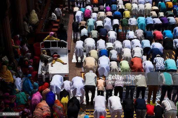 Indian Muslims offer prayers on the last Friday of the holy month of Ramadan at the Jama Masjid mosque ahead of the Muslim festival of Eid alFitr in...