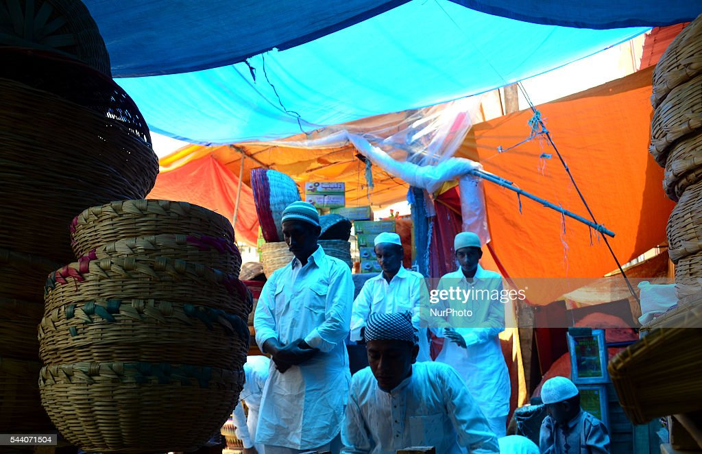 Indian muslims offer prayers outside a basket shop, on the last friday of holy month of Ramadan, in Allahabad on July 1,2016.Muslims throughout the world are marking the month of Ramadan, the holiest month of Islamic calander,by fasting from dawn till dusk.