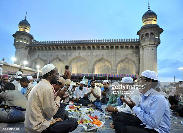 Indian Muslims offer prayers prior to breaking their fast on the first day of the holy fasting month of Ramadan at Mecca Masjid in Hyderabad on...