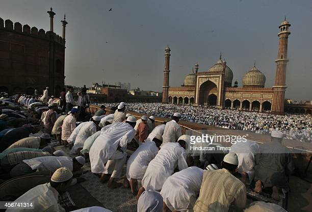 Indian Muslims offering prayers at Jama Masjid on the occasion of Eid alAdha or the Feast of the Sacrifice on October 6 2014 in New Delhi India Eid...